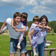 Happy young family have fun outdoors — Stock Photo #11939108