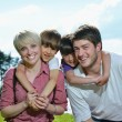 Happy young family have fun outdoors — Stock Photo #11939477