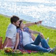 Happy young couple having a picnic outdoor — Stock Photo #11939530