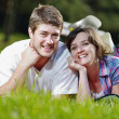 Happy young couple having a picnic outdoor — Stock Photo #11939715