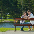 Portrait of romantic young couple smiling together outdoor — Stock Photo
