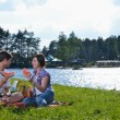 Happy young couple having a picnic outdoor - Stock fotografie