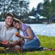 Happy young couple having a picnic outdoor — Stock Photo #11939923