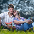Happy young couple having a picnic outdoor — Stock Photo #11939931