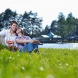 Happy young couple having a picnic outdoor — Stock Photo #11939937
