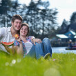 Happy young couple having a picnic outdoor — Stock Photo #11939947