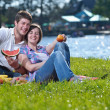 Happy young couple having a picnic outdoor — Stock Photo #11939952