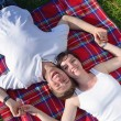Happy young couple having a picnic outdoor — Stock Photo #11939971