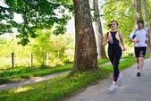 Young couple jogging — Стоковое фото