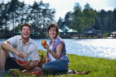 Happy young couple having a picnic outdoor — Stock Photo
