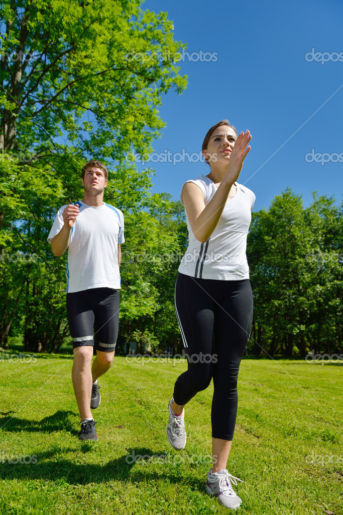 Young couple jogging in park at morning. Health and fitness. — Stock Photo #11936929