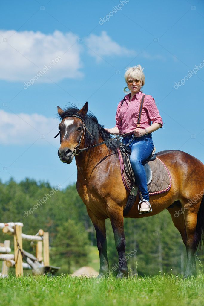 Happy woman ride horse — Stock Photo © .shock #11938809