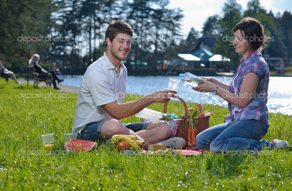Happy young romantic couple in love   having a picnic outdoor on a summer day  Stock Photo #11939795
