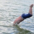 Man plunge into water — Stock Photo