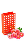 Gift bag and a bouquet of roses. — Stock Photo