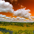 Panorama of river under orange sky — Stock Photo