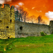Medieval fortification under orange sky — Stock Photo