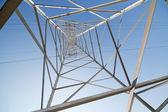 Inside of steel pylon on blue sky — Stock Photo