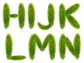 Sju isolerade brev från gröna blad — Stockfoto