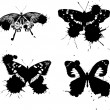 Four black butterflies with blots — Stock Vector