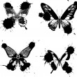 Four black butterflies in blots — Stock Vector