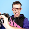 Man with camera — Stockfoto