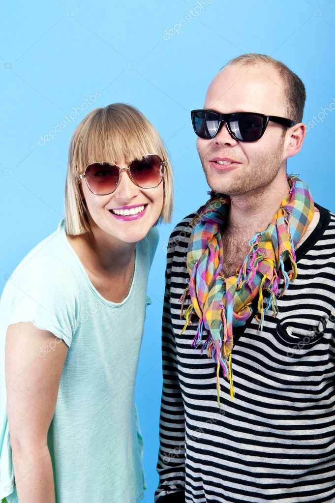 Woman and man togheter with sunglasses on blue background — Stock Photo #11591092