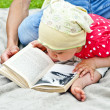 Stock Photo: Baby Reading A Book