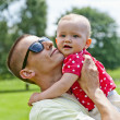 Stock Photo: Father Play With Baby Girl