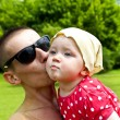 Father kissing His Baby — Stock Photo #11835376