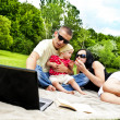 Family On Picnic Outdoor - Stock Photo