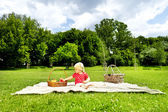 Baby On Picnic With Fruits — Stockfoto
