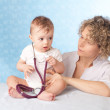 Female doctor and baby patient. — Stock Photo