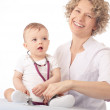 Stock Photo: Female doctor and baby patient.
