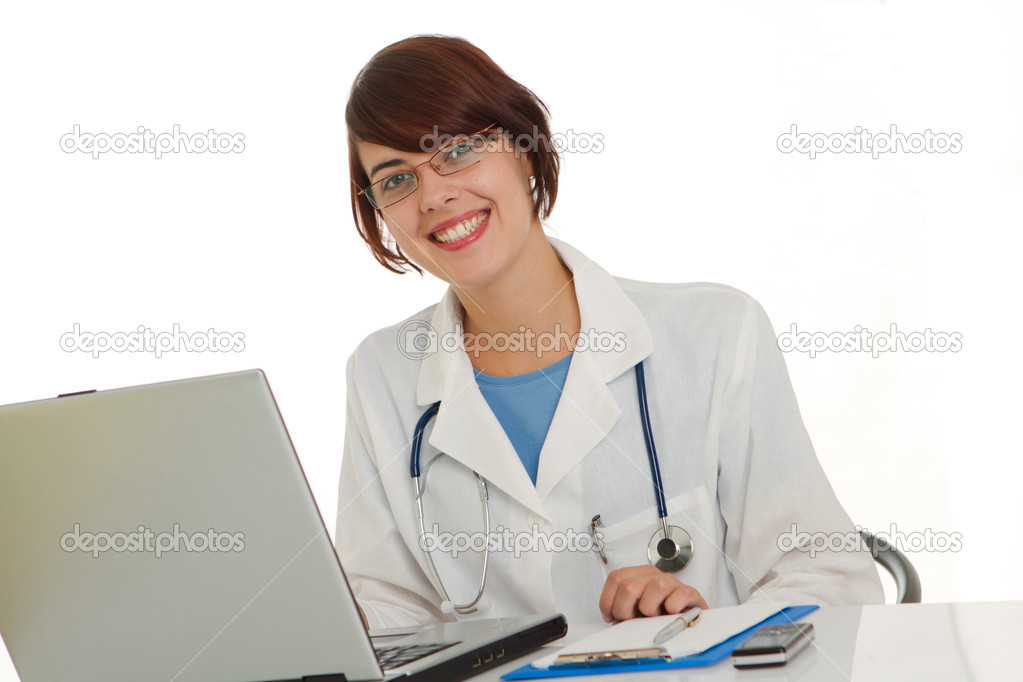 Female doctor write medical reports - at work use laptop  Stock Photo #12224857