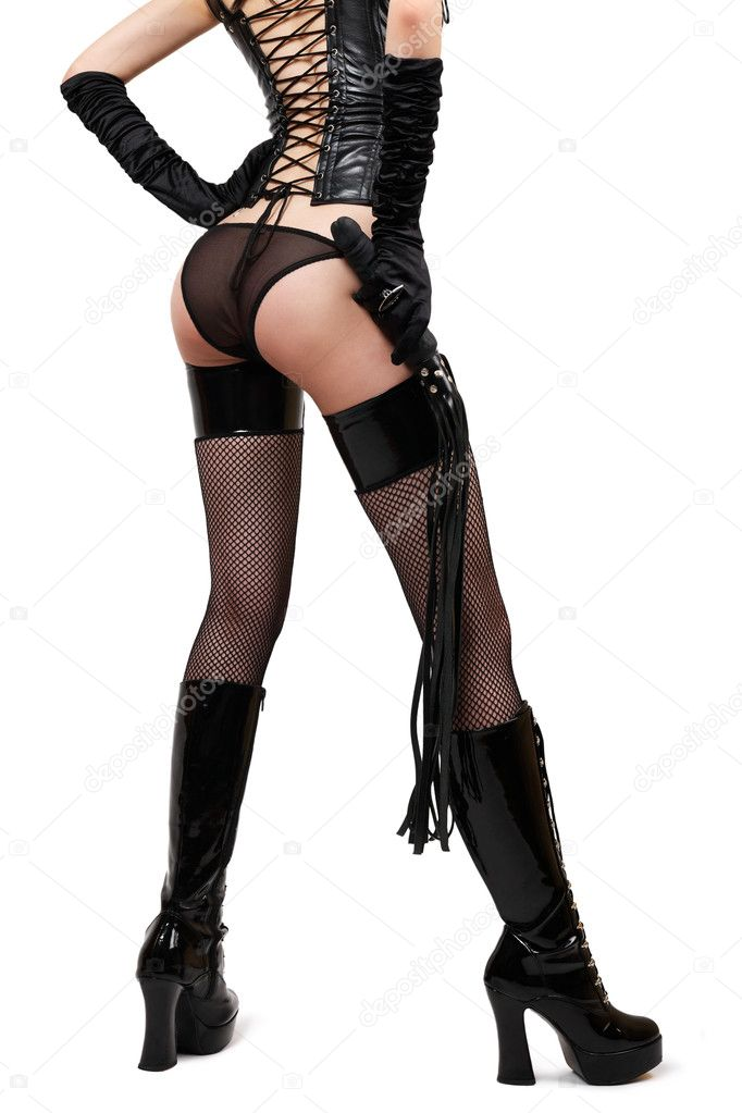 Sexy fetish woman in lingerie holding whip, isolated on white — Stock Photo #11952455