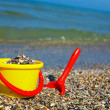 Plastic spade and bucket in sand — Stock Photo #11993218