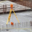 Equipment theodolite tool at construction site — Stock Photo #11834921