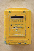 Old yellow postbox — Stock Photo