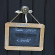 Small blackboard on a door lunch break message — Stock Photo