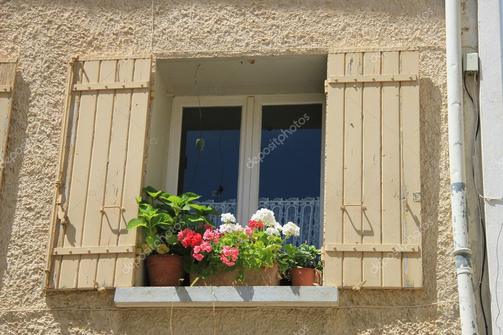 French style window with painted wooden shutters  Stock Photo #11315347