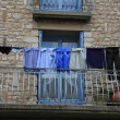 Laundry on a balcony — Stock Photo