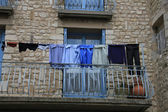 Laundry on a balcony — Stock Photo