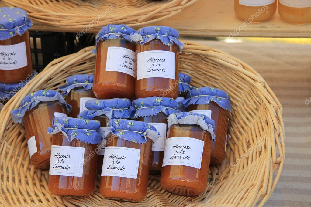 Jars with marmelade on a market in the Provence, France — Stock Photo #11396966