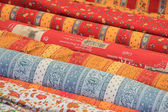 Rolls of Provencal textile on a market stall — Stock Photo