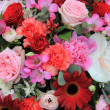 Mixed floral arrangement in red and pink — Stock Photo #11677375