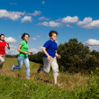 Active family - mother and kids running, jumping outdoor — Stock Photo #10769533