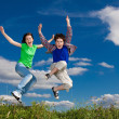 Girl and boy running, jumping outdoor — Stock Photo #10769606