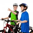 Cyclists - boy and girl isolated on white background — Stock Photo #10832830