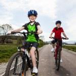 Girl and boy biking on cycle lane — Stock Photo #10833097